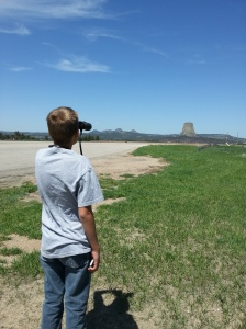 George viewing Devils Tower with his great-grandfather's binoculars.